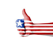 Hand with thumb up, Liberia  flag painted Royalty Free Stock Image