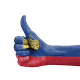 Hand with thumb up, Liechtenstein flag painted Royalty Free Stock Photography