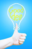Hand thumb up with lightbulb at blue background,Business concept Stock Images