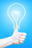 Hand thumb up with lightbulb at blue background,Business concept Stock Photography