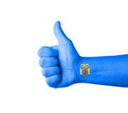 Hand with thumb up, Melilla  flag painted Royalty Free Stock Photo