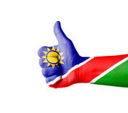 Hand with thumb up, Namibia  flag painted Royalty Free Stock Images