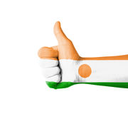 Hand with thumb up, Niger  flag painted Royalty Free Stock Images