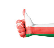 Hand with thumb up, Oman  flag painted Royalty Free Stock Images