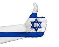 Hand with thumb up painted in colors of Israel flag isolated Royalty Free Stock Photography