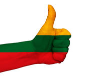 Hand with thumb up painted in colors of Lithuania flag isolated Royalty Free Stock Images