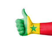 Hand with thumb up, Senegal  flag painted Royalty Free Stock Photo