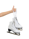 Hand with thumb up sign holding woman ice skates isolated Royalty Free Stock Photos