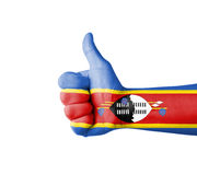 Hand with thumb up, Swaziland  flag painted Stock Image