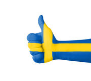 Hand with thumb up, Sweden  flag painted Royalty Free Stock Image