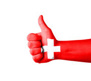 Hand with thumb up, Switzerland  flag painted Royalty Free Stock Photo