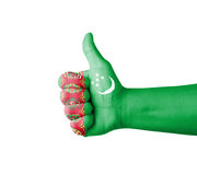 Hand with thumb up, Turkmenistan  flag painted Royalty Free Stock Images