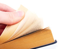 The hand thumbs through the book. Isolated Stock Photo