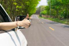 Hand thumbs car On the road Royalty Free Stock Photo