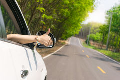 Hand thumbs car On the road Royalty Free Stock Photography