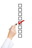 Hand ticking checkbox on To-Do list. With red checkmark Royalty Free Stock Photography