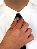 Hand and tie. Business man adjusting his tie Stock Images