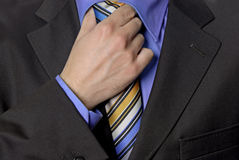 Hand tie. Detail of a Business man Suit with colored tie Stock Image