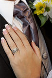 Hand Tie. A brides hand on grooms chest Royalty Free Stock Photography