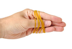 Hand tied with rubber bands isolated on a white Royalty Free Stock Photography