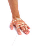 Hand tied with thread Royalty Free Stock Photo