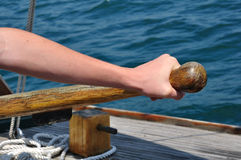Hand on Tiller Steering a Schooner Sailboat Stock Images