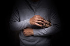 Hand with time bomb. Stock Images