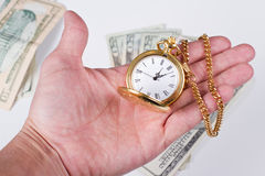 Hand, time and money Royalty Free Stock Image