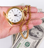 Hand, time and money Royalty Free Stock Photo