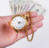 Hand, time and money Royalty Free Stock Photography