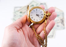 Hand, time and money Stock Photos