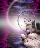 Hand and time. Hand and spiraling time with rainbow Royalty Free Stock Images