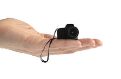 Hand Tiny Camera (isolated on white) Royalty Free Stock Image