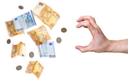 Hand about to grab money Stock Photo