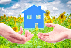 From hand to hand the house. Stock Photo