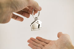 From hand to hand, new apartment property Stock Image