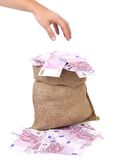 Hand to sack with euro bills. Royalty Free Stock Image