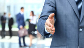 Hand to shake. Businessman extending hand to shake Royalty Free Stock Photo