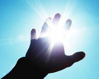 Hand to sun Royalty Free Stock Images