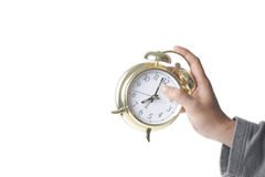 Hand about to throw the alarm clock Stock Images