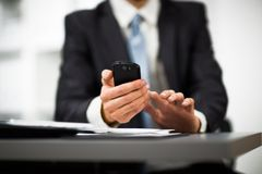 Hand to use a smartphone Stock Photography