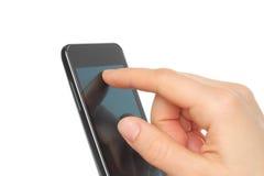 Hand toching smart phone Stock Photos
