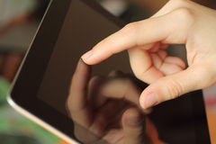 Hand toching tablet PC Stock Photo