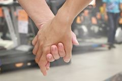 Hand in hand together forever on selective focus. Hand in hand together in shopping mall on selective focus Royalty Free Stock Images