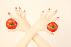 Hand with tomato. royalty free stock photos