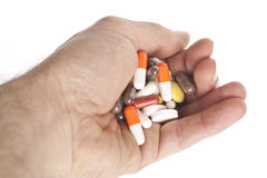 Hand with too many tablets Stock Photography