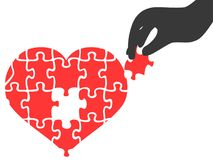 Hand took heart jigsaw puzzle piece. Isolated hand took heart jigsaw puzzle piece on white background Stock Image