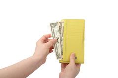 Hand took some bills out of a wallet Royalty Free Stock Images
