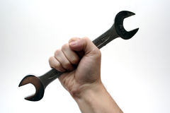 Hand with tool. On white background Royalty Free Stock Photo