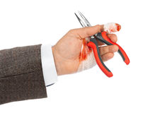 Hand with tool and bandage Royalty Free Stock Photo